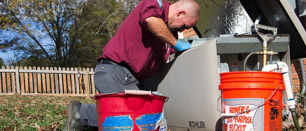 Technician providing electrical generator maintenance