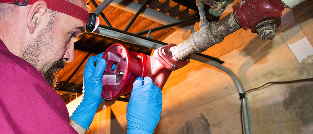Technician providing heating boiler installation