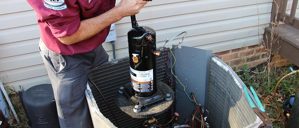 Technician installing a heat pump