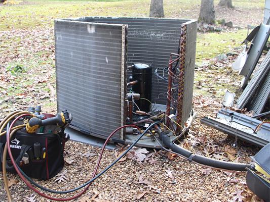 Technician repairing an air conditioner