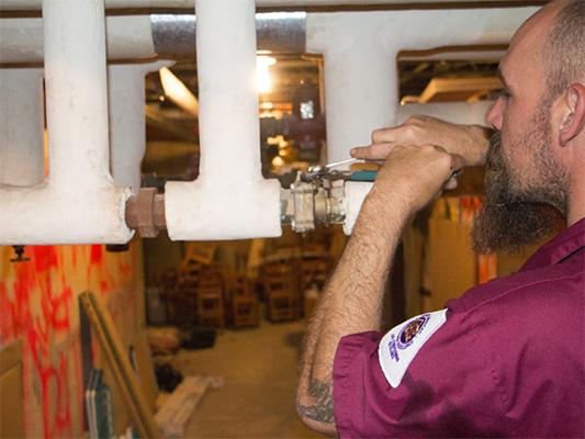 Technician installing a boiler