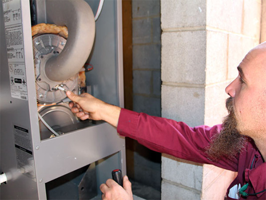 Technician providing boiler maintenance