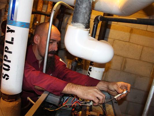 Technician repairing boiler