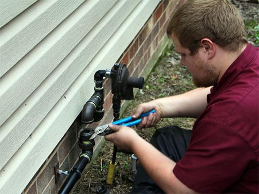 Technician installing a generator
