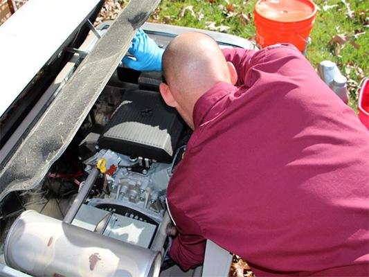 Technician providing generator maintenance