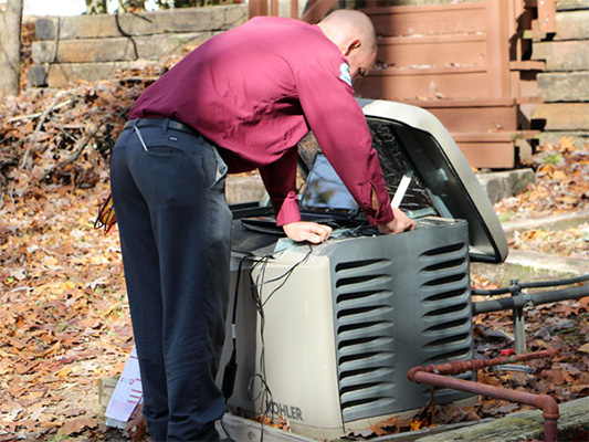 Technician repairing a generator