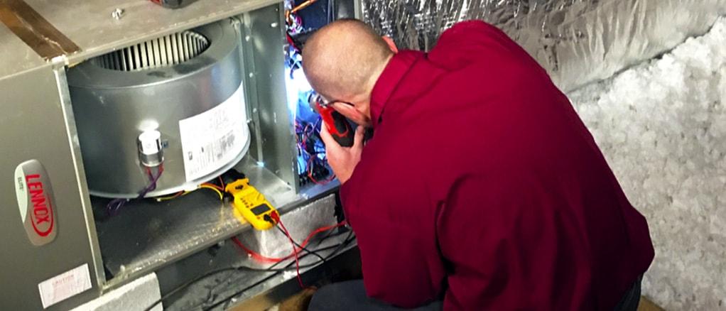 Technician repairing a HVAC heat issues