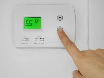 setting a thermostat to 66 degrees