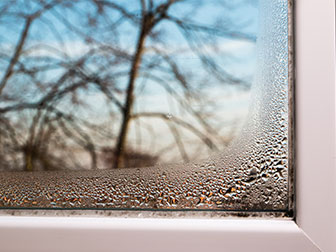 window view from indoors with water on the inside due to ventilation and humidity