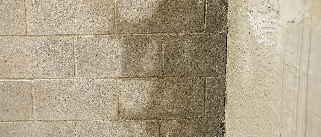 damp crawl space with moisture on the cement bricks