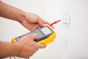 electrician checking power outlet