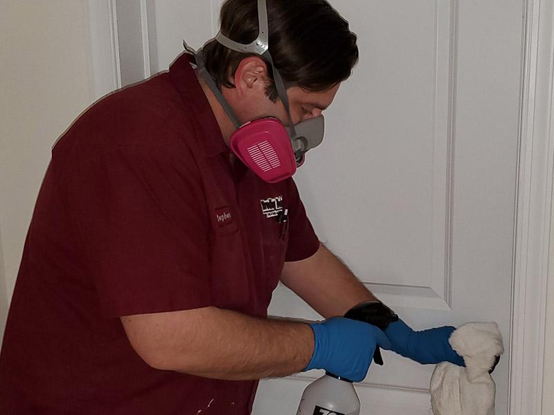 Contactless Technician Wiping down door knob
