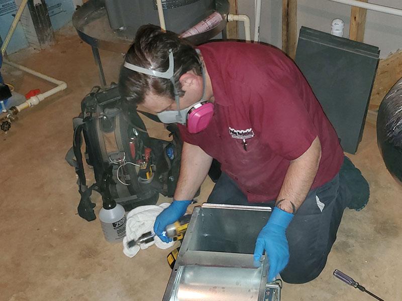 Contactless Technician inspecting blower